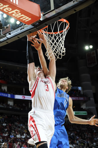 HOUSTON, TX - MARCH 3: Omer Asik #3 of the Houston Rockets dunks the ball against Dirk Nowitzki #41 of the Dallas Mavericks on March 3, 2013 at the Toyota Center in Houston, Texas. (Photo by Bill Baptist/NBAE via Getty Images)