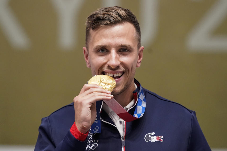 Gold medalist Jean Quiquampoix, of France, celebrates after the men's 25-meter rapid fire pistol at the Asaka Shooting Range in the 2020 Summer Olympics, Monday, Aug. 2, 2021, in Tokyo, Japan. (AP Photo/Alex Brandon)