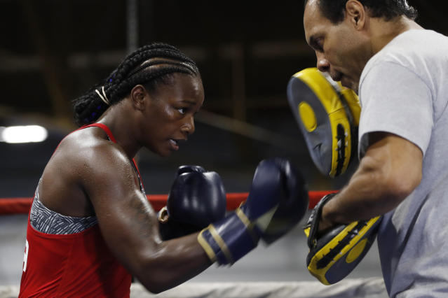 Claressa Shields spars with trainer John David Jackson during a training session, Wednesday, Oct. 2, 2019, in Detroit. Shields will fight Croatian boxer Ivana Habazin for the vacant World Boxing Organization Junior Middleweight title in Flint, Mich., on Saturday night. (AP Photo/Carlos Osorio)