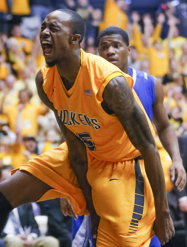 Wichita State's Nick Wiggins celebrates a dunk during the first half of an NCAA college basketball game against Drake on Saturday, Feb. 22, 2014, at Koch Arena in Wichita, Kan. (AP Photo/The Wichita Eagle, Travis Heying)