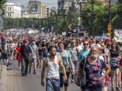 People march during a protest in support of Sergei Furgal, the governor of the Khabarovsk region, in Khabarovsk, 6100 kilometers (3800 miles) east of Moscow, Russia, Saturday, July 18, 2020. Tens of thousands of people in the Russian Far East city of Khabarovsk took to the streets on Saturday, protesting the arrest of the region's governor on charges of involvement in multiple murders. Local media estimated the rally in the city attracted from 15,000 to 50,000 people. (AP Photo/Igor Volkov)