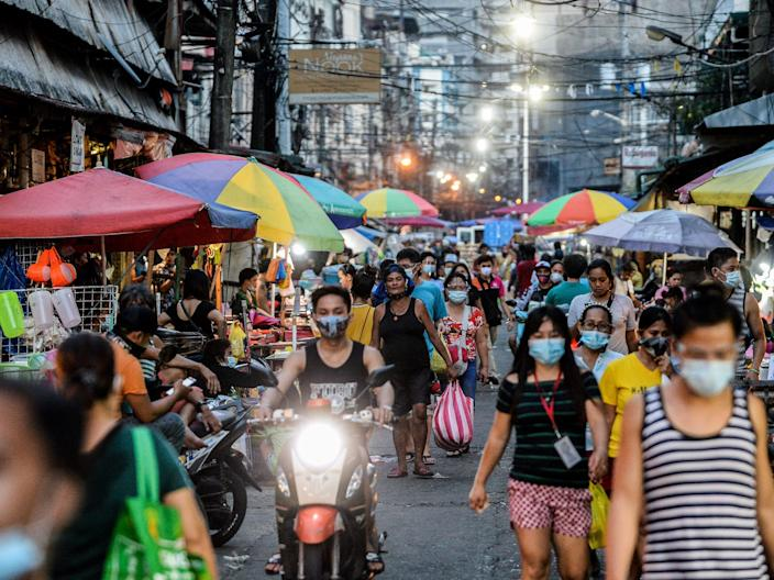 """People shop at a public market in Manila, Philippines on August 23, 2020. <p class=""""copyright"""">Lisa Marie David/NurPhoto via Getty Images)</p>"""