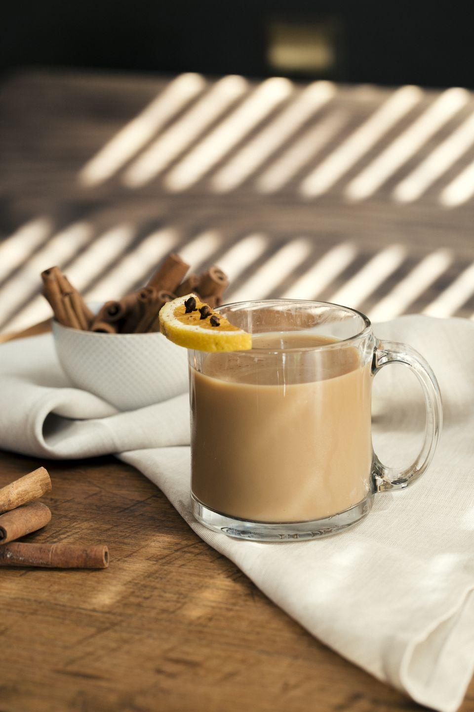"""<p>Snuggle up in bed on a Sunday morning with this creamy drink. Or serve it to warm up after the hayride.<br><strong><br></strong><strong>Ingredients:</strong></p><p>2 oz. <a href=""""https://drizly.com/liquor/liqueur/baileys-irish-cream-pumpkin-spice/p58358?is_autocomplete=true"""" rel=""""nofollow noopener"""" target=""""_blank"""" data-ylk=""""slk:Baileys Pumpkin Spice"""" class=""""link rapid-noclick-resp"""">Baileys Pumpkin Spice</a><br>1/2 oz. Cinnamon Syrup<br>Hot Apple Cider to Top<br>Orange Wedge and Cloves for Garnish</p><p><strong>Directions:</strong></p><p>Combine Baileys Pumpkin Spice and cinnamon syrup into a cocktail shaker. Shake well. Strain contents into a coffee mug and top with hot apple cider. Garnish with orange wedge and cloves.</p>"""