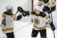 Boston Bruins center Curtis Lazar (20) celebrates his goal with defenseman Jarred Tinordi (84) during the second period of an NHL hockey game against the Washington Capitals, Tuesday, May 11, 2021, in Washington. (AP Photo/Nick Wass)