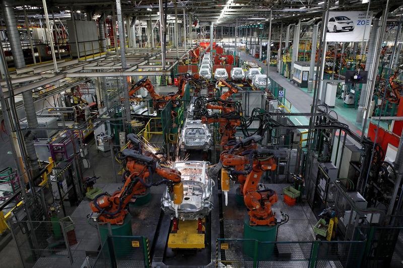 Robots assemble Renault and Nissan automobiles on the production line at the Renault SA car factory in Flins