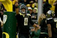 Oregon quarterback Marcus Mariota (8) points to the crowd after scoring a touchdown during the first quarter against Stanford in an NCAA college football game in Eugene, Ore., Saturday, Nov. 1, 2014. (AP Photo/Ryan Kang)