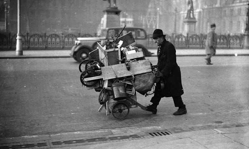 10th December 1936: A tramp pushing his belongings in a cart through Parliament Square, Westminster.