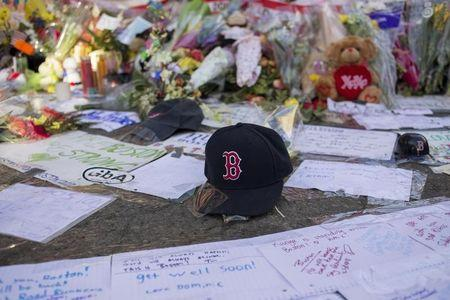A Boston Red Sox hat is seen among a makeshift memorial for the victims of the Boston Marathon bombings on Boylston street in Boston, Massachusetts