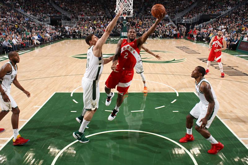 MILWAUKEE, WI - MAY 23: Kawhi Leonard #2 of the Toronto Raptors goes to the basket against the Milwaukee Bucks during Game Five of the Eastern Conference Finals on May 23, 2019 at the Fiserv Forum in Milwaukee, Wisconsin. NOTE TO USER: User expressly acknowledges and agrees that, by downloading and/or using this photograph, user is consenting to the terms and conditions of the Getty Images License Agreement. Mandatory Copyright Notice: Copyright 2019 NBAE (Photo by Gary Dineen/NBAE via Getty Images)
