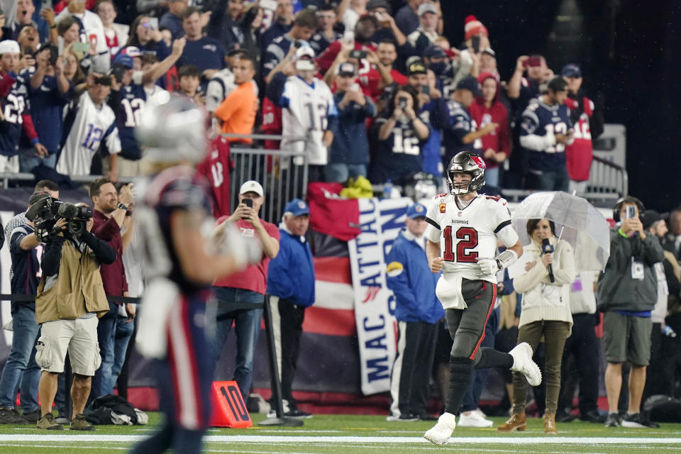 Tampa Bay Buccaneers quarterback Tom Brady (12) runs onto the field at Gillette Stadium prior to an NFL football game between the New England Patriots and Tampa Bay Buccaneers, Sunday, Oct. 3, 2021, in Foxborough, Mass. (AP Photo/Steven Senne)