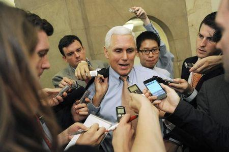 Pence talks with reporters as he departs a meeting about debt ceiling legislation with fellow Republicans at the U.S. Capitol in Washington