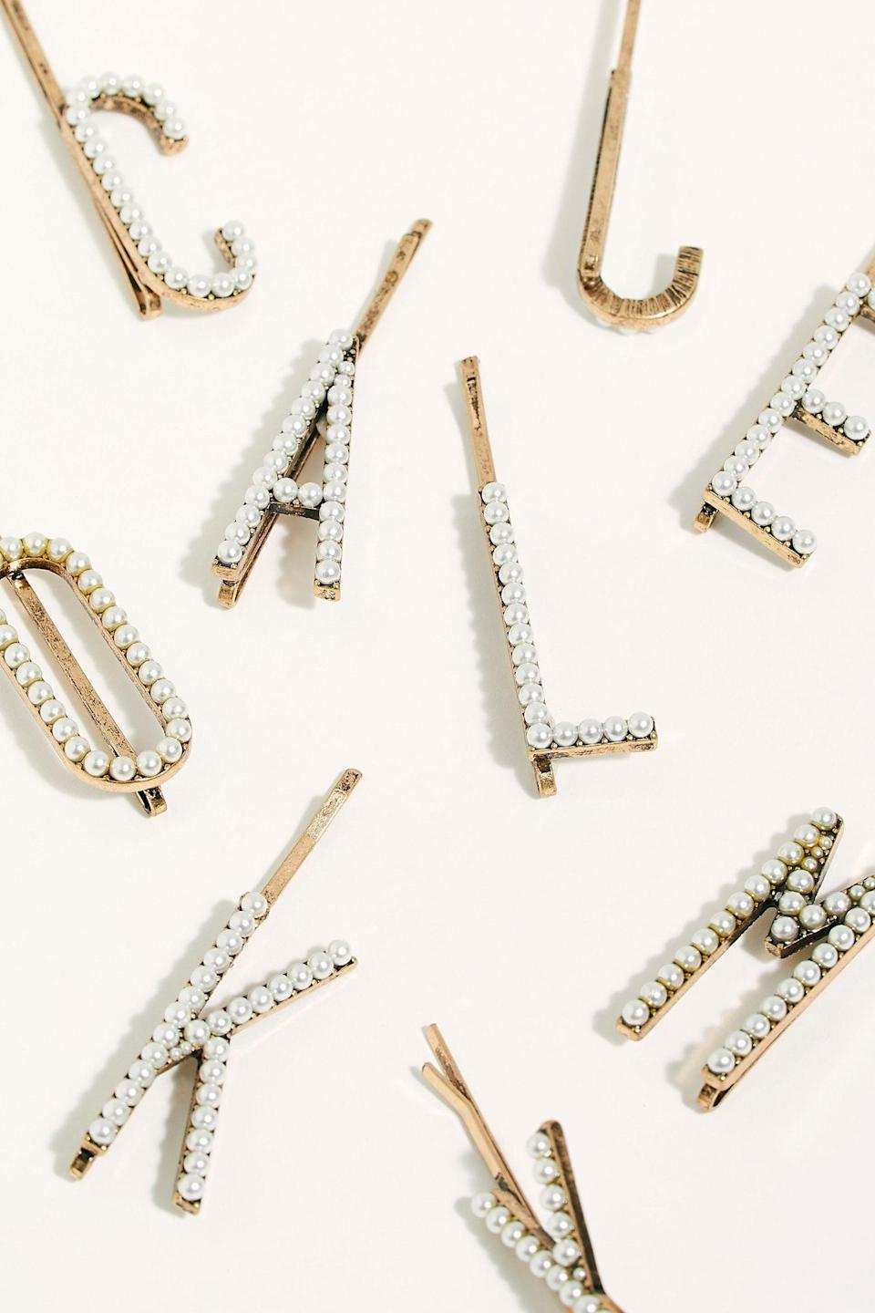 """<p>How cute are these <a href=""""https://www.popsugar.com/buy/Pearl-Letter-Bobby-Pins-530406?p_name=Pearl%20Letter%20Bobby%20Pins&retailer=freepeople.com&pid=530406&price=12&evar1=fab%3Aus&evar9=36282856&evar98=https%3A%2F%2Fwww.popsugar.com%2Fphoto-gallery%2F36282856%2Fimage%2F47004708%2FPearl-Letter-Bobby-Pins&list1=shopping%2Cgifts%2Choliday%2Cgift%20guide%2Choliday%20fashion%2Cfashion%20gifts%2Cgifts%20for%20women&prop13=api&pdata=1"""" class=""""link rapid-noclick-resp"""" rel=""""nofollow noopener"""" target=""""_blank"""" data-ylk=""""slk:Pearl Letter Bobby Pins"""">Pearl Letter Bobby Pins</a> ($12)?</p>"""