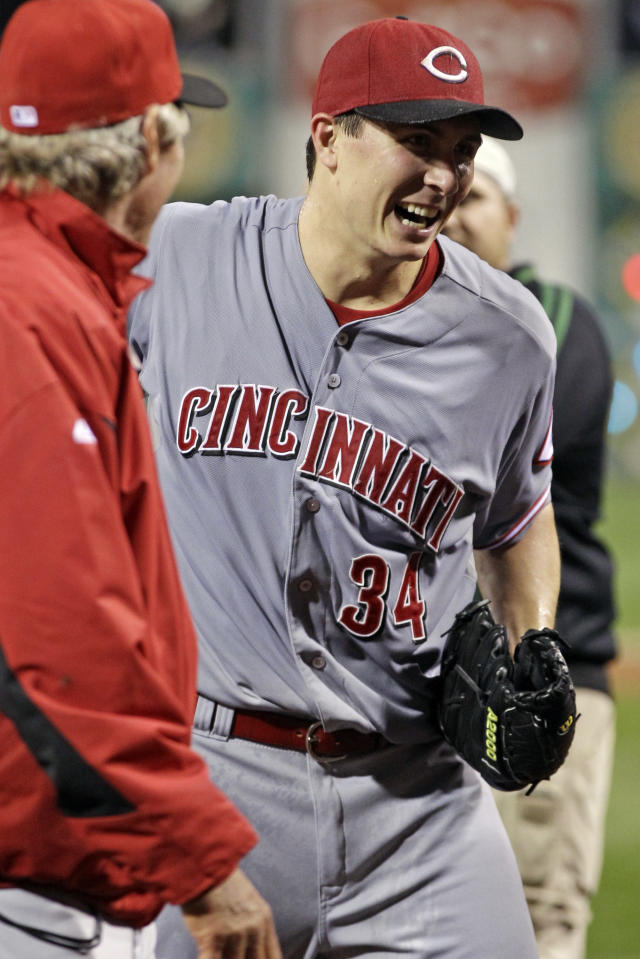 Cincinnati Reds bench coach Chris Speier, left, celebrates with Cincinnati Reds starting pitcher Homer Bailey (34) after getting the final out of a no-hitter in a baseball game against the Pittsburgh Pirates in Pittsburgh Friday, Sept. 28, 2012. The Reds won 1-0. (AP Photo/Gene J. Puskar)