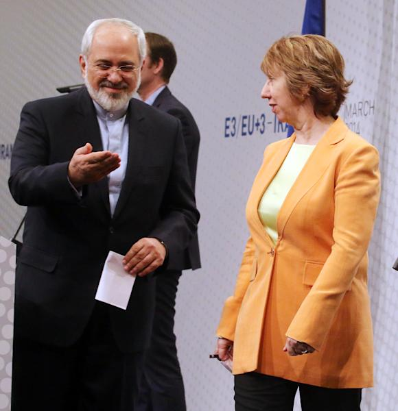 European foreign policy chief Catherine Ashton, left, and Iranian Foreign Minister Mohamad Javad Zarif, right, leave a news conference after closed-door nuclear talks in Vienna, Austria, Wednesday, March 19, 2014. They said the talks addressed Iran's uranium enrichment program, a nearly finished nuclear reactor and the lifting of sanctions on Iran that have been imposed successively over the past decade as Tehran expanded its atomic activities. The talks will resume April 7 in Vienna. (AP Photo/Ronald Zak)