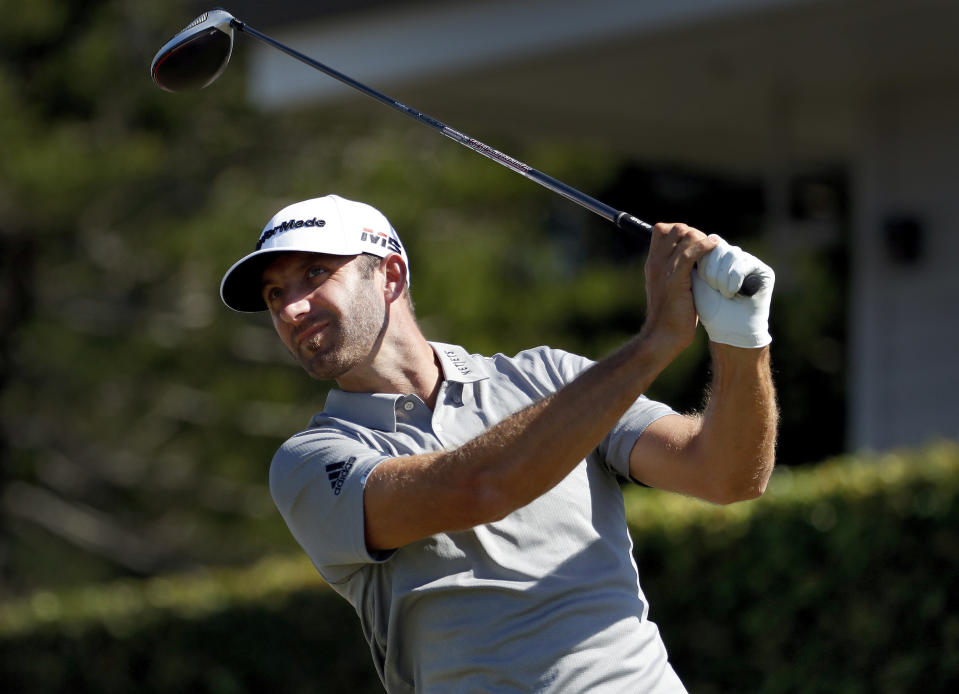 FILE - In this Jan. 6, 2019, file photo, defending champion Dustin Johnson plays his shot from the first tee during the final round of the Tournament of Champions golf event at Kapalua Plantation Course in Kapalua, Hawaii. Johnson is among top players scheduled for a new golf tournament in Saudi Arabia at the end of January. (AP Photo/Matt York, File)