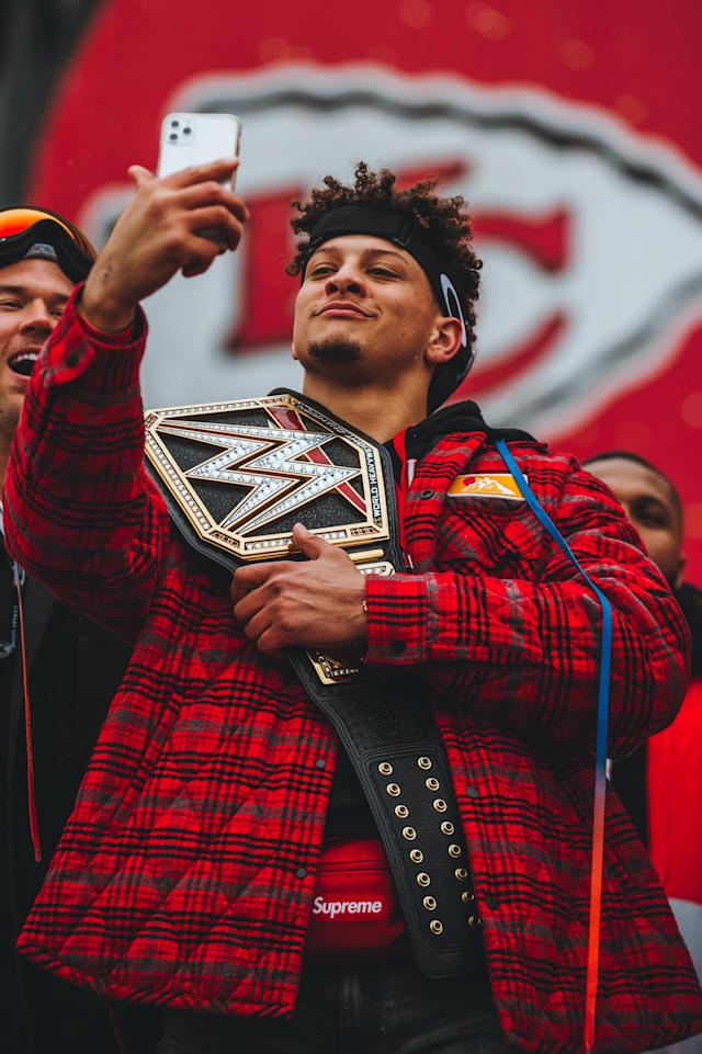 "Kansas City Chiefs QB <a class=""link rapid-noclick-resp"" href=""/nfl/players/30123/"" data-ylk=""slk:Patrick Mahomes"">Patrick Mahomes</a> poses with a custom-made WWE championship belt days after winning Super Bowl LIV. (Photo credit: Kansas City Chiefs)"