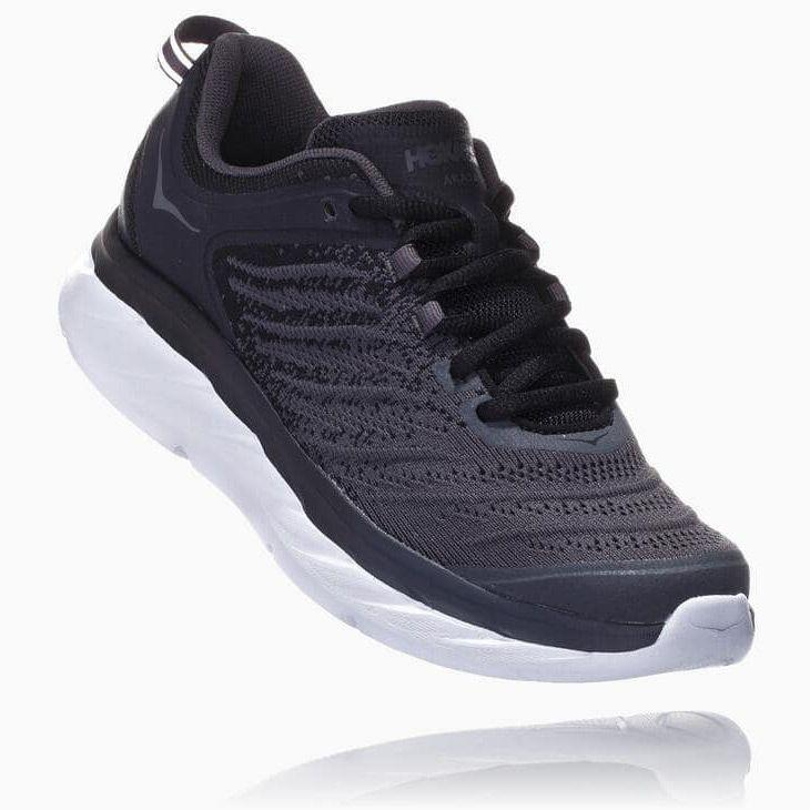 """<p><strong>Hoka One One</strong></p><p>zappos.com</p><p><strong>$140.00</strong></p><p><a href=""""https://go.redirectingat.com?id=74968X1596630&url=https%3A%2F%2Fwww.zappos.com%2Fp%2Fhoka-one-one-akasa-black-dark-shadow%2Fproduct%2F9140529&sref=https%3A%2F%2Fwww.goodhousekeeping.com%2Fhealth-products%2Fg32379201%2Fbest-workout-shoes-for-women%2F"""" rel=""""nofollow noopener"""" target=""""_blank"""" data-ylk=""""slk:Shop Now"""" class=""""link rapid-noclick-resp"""">Shop Now</a></p><p>With a Plantar Fasciitis diagnosis, you want to make sure your workout shoes have a deep heel cup and plenty of arch support to avoid any pain. Hoka sneakers are popular among Plantar Fasciitis sufferers as they have the brand's <strong>""""Active Foot Frame"""" that supports the heel to prevent muscle strain. </strong>Plus, they have Hoka's signature foam midsole without the bulky appearance of traditional orthotic shoes.</p>"""