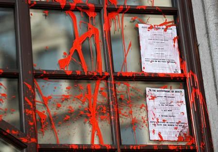 London climate change protesters daub Brazilian embassy blood red