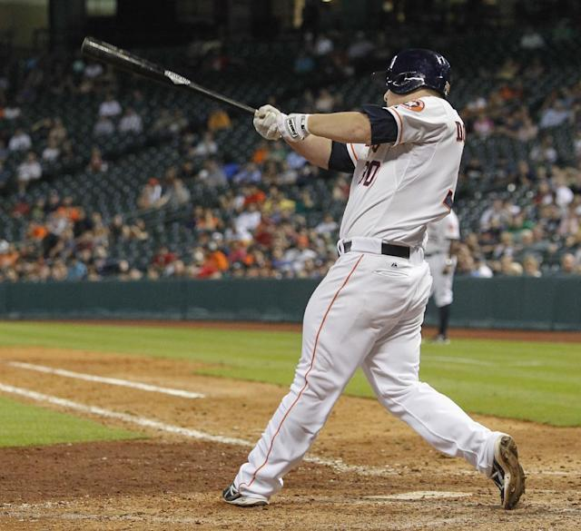 Houston Astros' Matt Dominguez hits a two-run home run in the ninth inning against the Oakland Athletics during a baseball game Tuesday, July 23, 2013, in Houston. (AP Photo/Bob Levey)