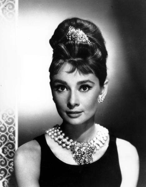 """In this image released by Paramount Pictures, Audrey Hepburn is shown in a scene from """"Breakfast at Tiffany's."""" Memorable movies, including """"Breakfast at Tiffany's,"""" """"Dirty Harry,"""" """"A League of Their Own"""" and """"The Matrix"""" are being preserved for their enduring significance in American culture as The Library of Congress announces, Wednesday, Dec. 19, 2012, the slate of films it will induct into the National Film Registry.(AP Photo/Paramount Pictures) ** NO SALES **"""