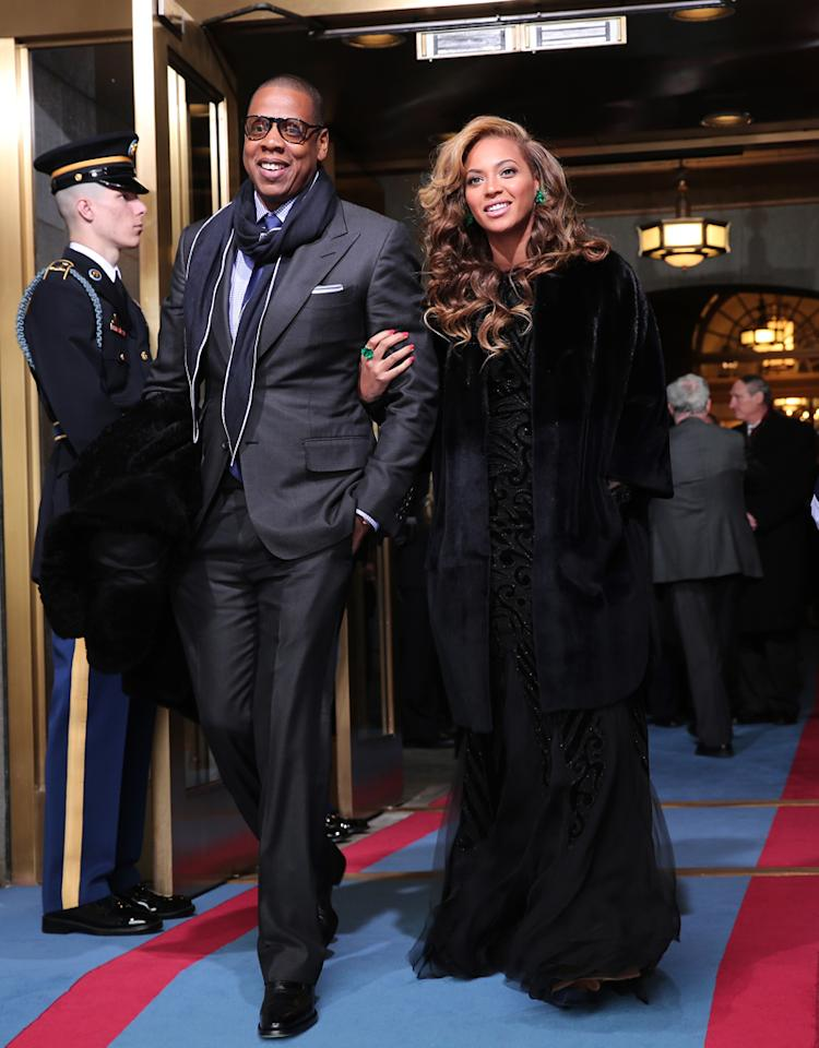 WASHINGTON, DC - JANUARY 21: Recording artists Jay-Z and Beyonce arrive at the presidential inauguration on the West Front of the U.S. Capitol January 21, 2013 in Washington, DC. Barack Obama was re-elected for a second term as President of the United States. (Photo by Win McNamee/Getty Images)