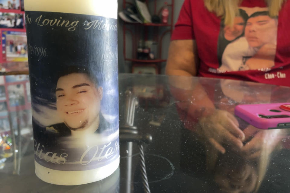This July 15, 2021 image shows one of the memorial candles for Elias Otero at his family's home in Albuquerque, New Mexico. Otero, 24, is among the people killed in the city so far this year. Albuquerque is on track to smash its homicide record of 80 that was set in 2019. Homicide rates in many American cities have continued to rise although not as precipitously as the double-digit jumps seen in 2020 and still below the violence of the mid-90s. (AP Photo/Susan Montoya Bryan)