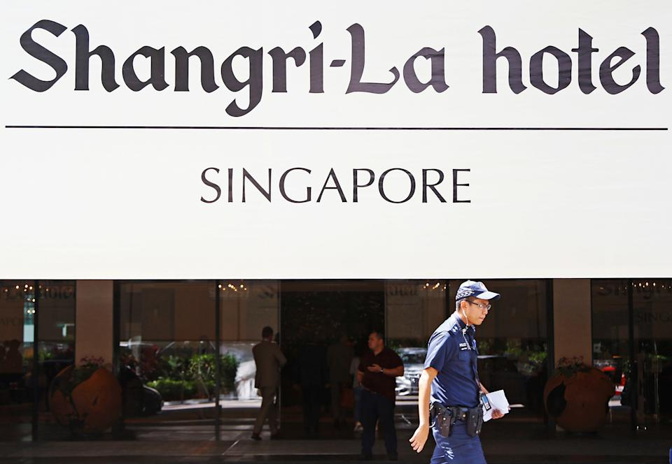 A police officer walks outside the venue of the 2019 IISS Shangri-La Dialogue in Singapore. (PHOTO: Reuters)