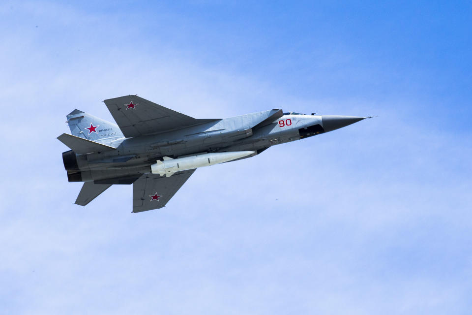 FILE In this file photo taken on Wednesday, May 9, 2018, a Russian Air Force MiG-31K jet carries a high-precision hypersonic aero-ballistic missile Kh-47M2 Kinzhal during the Victory Day military parade to celebrate 73 years since the end of WWII and the defeat of Nazi Germany, in Moscow, Russia. The Russian military says it launched maneuvers in the eastern Mediterranean that involve MiG-31 armed with the new Kinzhal hypersonic missiles, which arrived at the Russian airbase in Syria for the exercise. (AP Photo/Alexander Zemlianichenko, File)