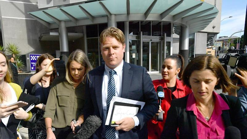 Brisbane nightclub lobbyist Nick Braban (centre) has been fined for snorting cocaine in a car park.
