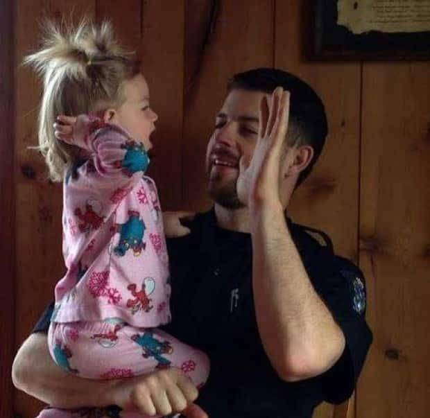 Bryce Casavant and his daughter Athena. Casavant, who made headlines in 2015 after he refused to kill two orphaned bear cubs, has sued to get his old job with the B.C. Conservation Officer Service back after a legal battle that went all the way to the Supreme Court of Canada. (Submitted by Bryce Casavant - image credit)