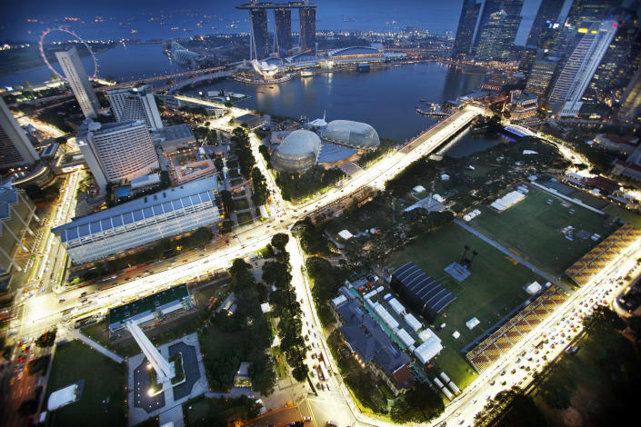 The street circuit of the Formula One night race is illuminated during a light testing seen from Swissotel The Stamford at dusk on Monday, Sept. 19, 2011 in Singapore which will be the host city for the SingTel Singapore Grand Prix from Sept. 23-25. (AP Photo/Wong Maye-E)