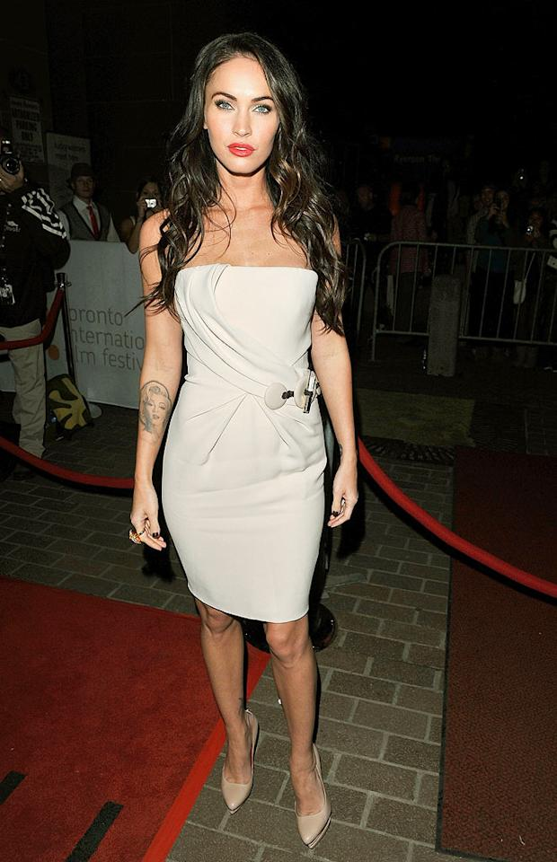"""Megan Fox has been MIA on the red carpet ever since the release of her box office bomb, """"Jonah Hex,"""" back in June, but Mrs. Brian Austin Green resurfaced in style for the premiere of """"Passion Play"""" at the 35th Toronto International Film Festival in a pristine Armani Prive cocktail dress and nude Cesare Paciotti heels. George Pimentel/<a href=""""http://www.wireimage.com"""" target=""""new"""">WireImage.com</a> - September 10, 2010"""