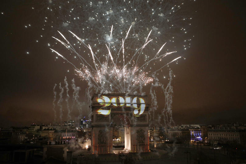 Fireworks explode over the Arc de Triomphe during the New Year's Day celebrations on the Champs Elysees in Paris