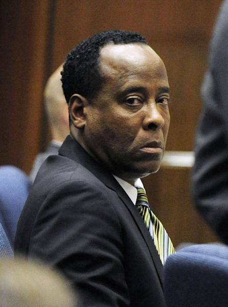 "FILE - In this Oct. 27, 2011 file photo, Dr. Conrad Murray listens to testimony by Dr. Paul White, an anesthesiologist and propofol expert, during Dr. Conrad Murray's involuntary manslaughter trial in Los Angeles. The attorney who drafted the agreement for Michael Jackson's doctor to work on the singer's ""This Is It"" shows told a Los Angeles jury on Tuesday, Aug. 6, 2013, that the physician told her his clinics earned more than $1 million a month and she told the CEO of the concert promoter AEG Live LLC that he appeared to be successful. Kathy Jorrie's testimony came in a negligence lawsuit filed by Jackson's mother against AEG Live, claiming the company failed to adequately investigate Dr. Conrad Murray, who was convicted of giving the singer a fatal dose of anesthesia in June 2009. (AP Photo/Paul Buck, Pool, File)"