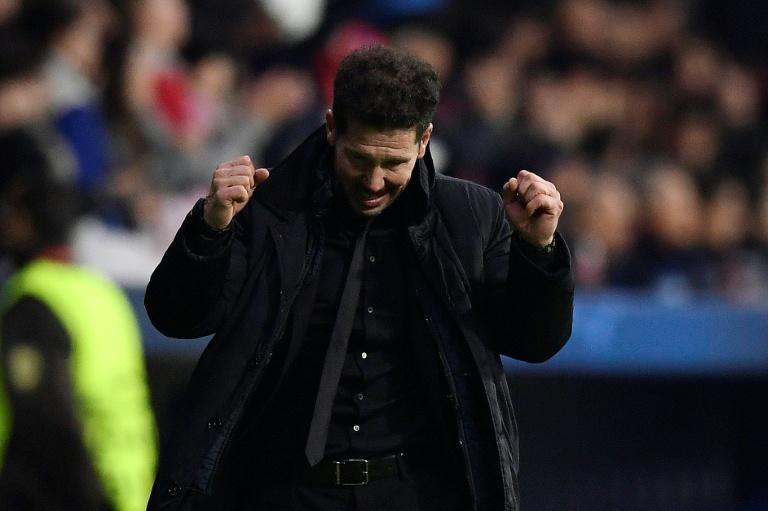 Atletico Madrid's head coach Diego Simeone celebrates after his team's second goal during their UEFA Champions League Group C match against AS Roma, at the Wanda Metropolitan Stadium in Madrid, on November 22, 2017