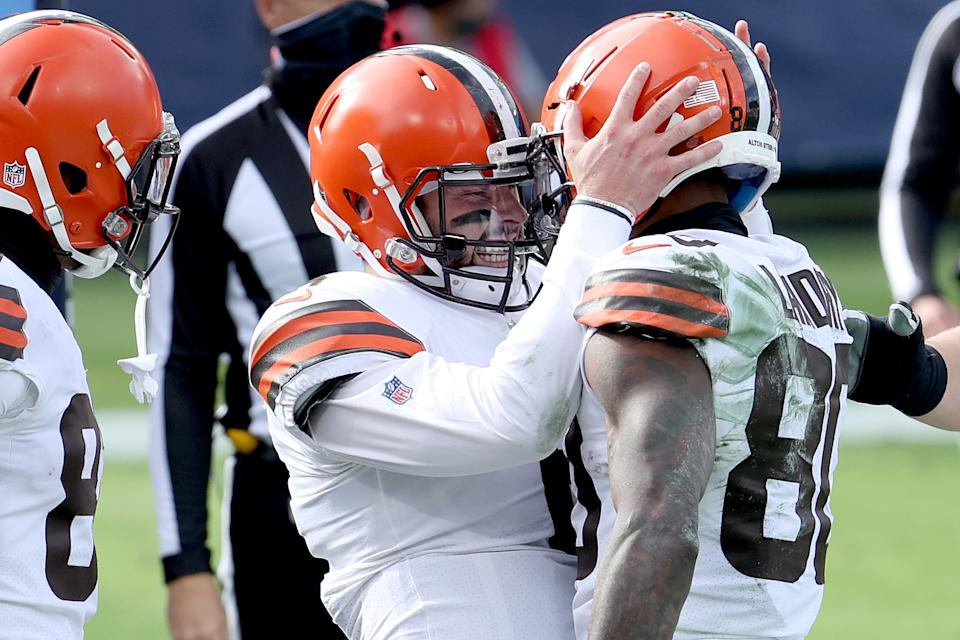 Cleveland Browns quarterback Baker Mayfield locks helmets with wide receiver Jarvis Landry to celebrate a touchdown.