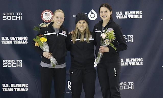 From left to right, second-place finisher Emily Scott, first-place finisher Jessica Smith and third-place finisher Alyson Dudek celebrate on the podium after the women's 500 meters during the U.S. Olympic short track speedskating trials on Saturday, Jan. 4, 2014, in Kearns, Utah. (AP Photo/Rick Bowmer)
