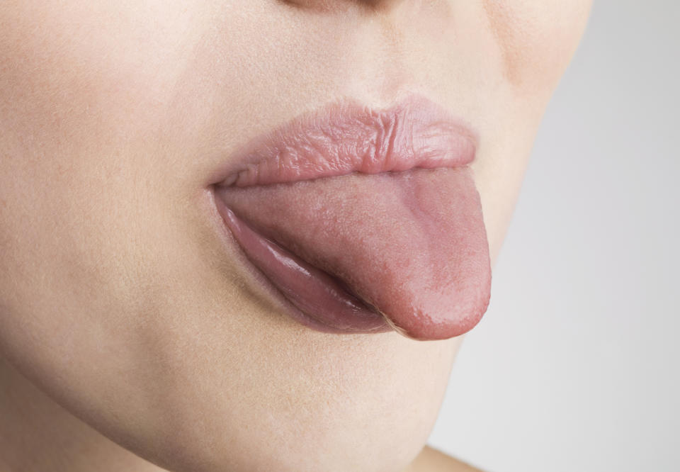 Why we should be adding tongue scraping to our oral routine (Getty)