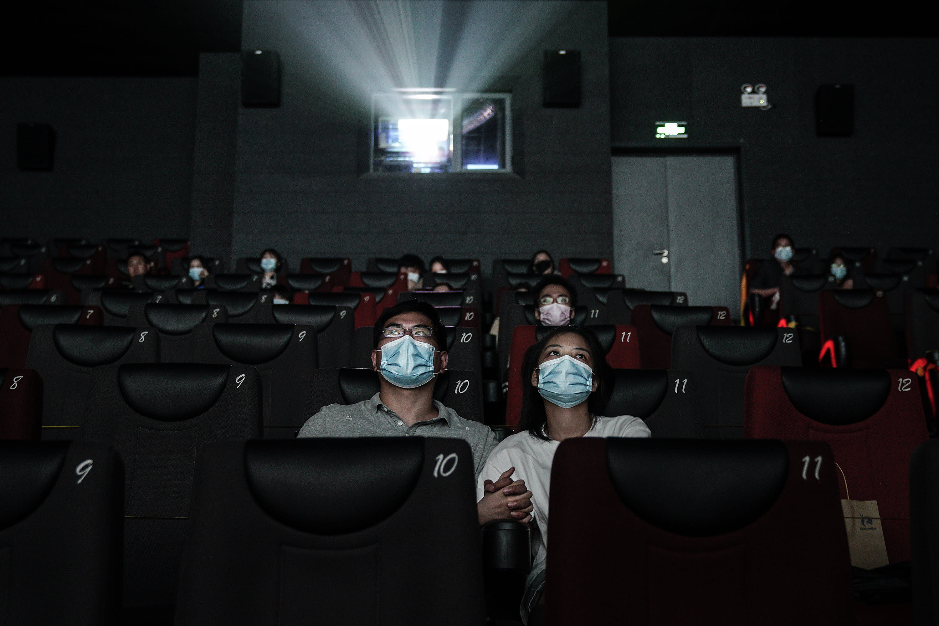 WUHAN, CHINA - JULY 20: (CHINA OUT)Residents watch a movie in a cinema in Wuhan on July 20, 2020 in Wuhan ,Hubei Province,China.Taking various measures against COVID-19, cinemas in the city reopened in an orderly manner on Monday. The China Film Administration, in a circular last week, allowed cinemas in low-risk areas to resume operation with effective epidemic prevention measures in place. (Photo by Getty Images)
