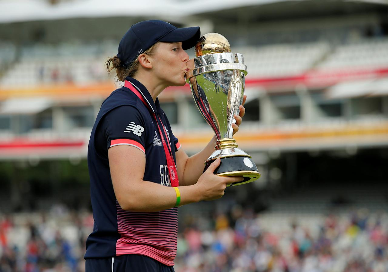 Cricket - Women's Cricket World Cup Final - England vs India - London, Britain - July 23, 2017   England's Heather Knight celebrates winning the world cup by kissing the trophy    Action Images via Reuters/Andrew Couldridge     TPX IMAGES OF THE DAY