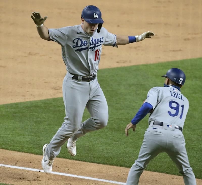 Dodgers catcher Will Smith celebrates with third base coach Dino Ebel after hitting a three-run home run.
