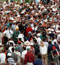 <p>Masters champion Tiger Woods is engulfed by the gallery as he makes his way to the 18th after his second shot during final round play at the Augusta National Golf Club in Augusta, Ga., Sunday, April 13, 1997. (AP Photo/Amy Sancetta ) </p>