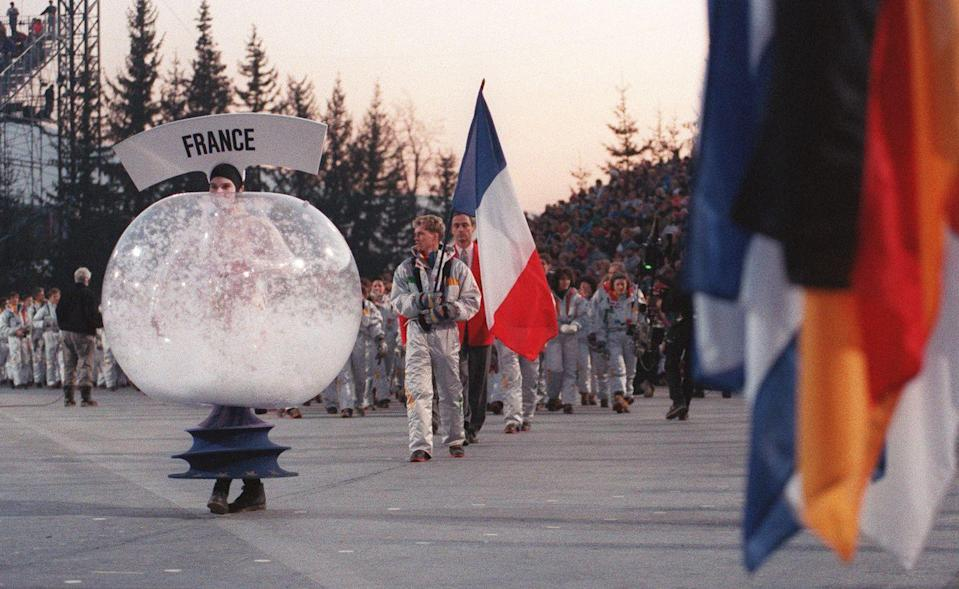 <p>Women dressed in elaborate snow globe costumes lead the different delegations at the 1992 Winter Olympic Games in Albertville. </p>