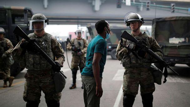 PHOTO: A man confronts a National Guard member as they guard the area in the aftermath of a protest against the death in Minneapolis police custody of African-American man George Floyd, in Minneapolis, Minnesota, May 29, 2020. (Carlos Barria/Reuters)