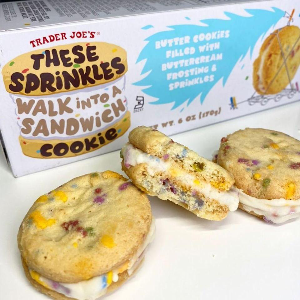"""<p>You're used to having ice cream sandwiches, but it's all about cookie sandwiches right now! Trader Joe's has a new treat, called <a href=""""https://www.traderjoes.com/fearless-flyer/article/5422"""" rel=""""nofollow noopener"""" target=""""_blank"""" data-ylk=""""slk:These Sprinkles Walk Into a Sandwich Cookie"""" class=""""link rapid-noclick-resp"""">These Sprinkles Walk Into a Sandwich Cookie</a>, that consists of two chunky butter cookies that are filled with buttercream frosting and colorful, confetti-like sprinkles. Get the party started by picking up a box of six cookie sandwiches for $2.99.</p>"""