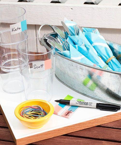 <p>Put home-office supplies to work: Plastic stick-on flags make perfect drink labels and rubber bands will secure napkin-wrapped cutlery, so partygoers can grab flatware one-handed. </p>