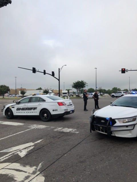 Police cars rush to a Walmart in Southaven, Miss., on July 30, 2019, after reports of an active shooter.