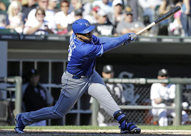 Kansas City Royals' Salvador Perez hits a single against the Chicago White Sox during the eighth inning of an MLB American League baseball game in Chicago, Sunday, Sept. 29, 2013. (AP Photo/Nam Y. Huh)