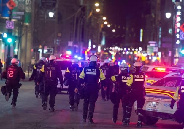 Police responding to an anti-curfew protests in Montreal in April.