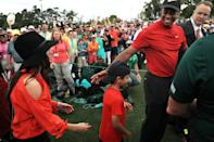 Tiger Woods (R) of the United States celebrates with his girlfriend Erica Herman (L) and son Charlie Axel (C) as he comes off the 18th green in celebration of his win during the final round of the Masters at Augusta National Golf Club on April 14, 2019 in Augusta, Georgia. (Photo by Mike Ehrmann/Getty Images)